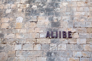 the inscription on an ancient stone wall of Santa Barbara castle. Alicante, Spain.